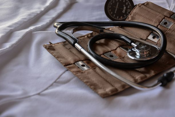 Stethoscope on top of felt pouch